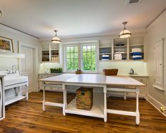 This would make a great sewing/laundry room!!