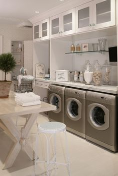 Love the glass in the cupboard doors! #laundryroom