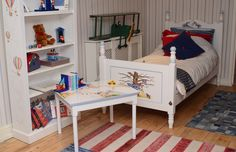 This delightful roomset visible within the Dragons of Walton Street showroom contains hand-painted Belle and Boo for boys artwork. Within this roomset is a Single William bed, a Large Lara shelf, a Play table and a Tri-Plane. www.dragonsofwaltonstreet.com