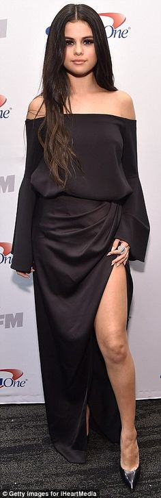 Selena Gomez shows toned leg in dress with high slit at Jingle Ball LA #dailymail