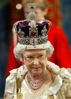 Queen Elizabeth II wearing the Imperial State Crown, United Kingdom (1937; diamonds, sapphires, emeralds, rubies, pearls, red spinel, gold, ermine, velvet).
