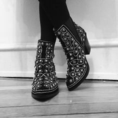 After Dark Boot | These pull-on ankle boots are diamond dazzlers. Bejeweled to the max, these black suede shoes have a western-inspired shape and star quality. Pointy toes and wood heels with a purpose. Elastic gussets for easy on-off.