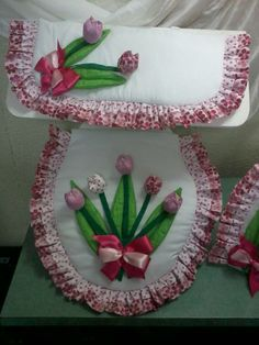 white with pink/white polka dot ruffled trim and raised floral applique with pink/red bow...