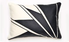 Leather applique pillow with an Art Deco design. Product: PillowConstruction Material: Leather and fiber fillColor: Vanilla and blackFeatures: Art deco designInsert includedDimensions: 16 H x 22 W