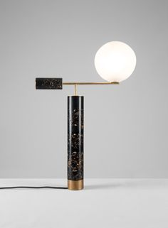 Marcin Rusak created a sleek material for furniture that is actually delicate flowers, captured in resin. It is both light and heavy, ephemeral and long lasting.  Naturelab-Flora_Lamp_02