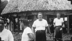 Mata'afa Faumuina Fiame Mulinu'u is seen facing the camera among other Samoan men. Behind him can be seen the Fono building, a traditional Samoan structure with a thatched roof supported by wooden pillars. Photographed by an unknown photographer in 1930. samoan heritag, faumuina fiam, unknown photograph, tradit samoan, samoan men, fiam mulinuu, 1930