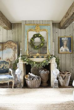 A French influenced fireplace and Christmas decorations in a lovely country home