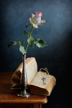"""Solo Rose - <a href=""""http://nikolay-panov.pixels.com/products/solo-rose-nikolay-panov-art-print.html"""">nikolay-panov.pix...</a> still life with single rose in small metal rusty vase, old book and key with bright blue wall on background"""