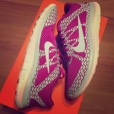 Nike Free 4.0. Women's Nike Free 4.0 magenta, light blue and white shoes. Never worn. Comes with box. Runs true to size. Nike Shoes Sneakers