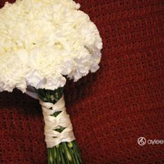 White carnation bouquet wrapped with tiffany blue ribbon
