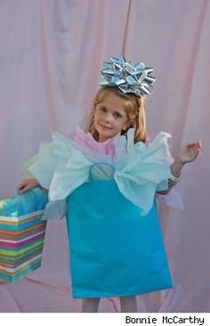 Gift bag costume idea - another easy one for the holiday parade - and a great way to reuse worn out larger gift bags from the basement!!!