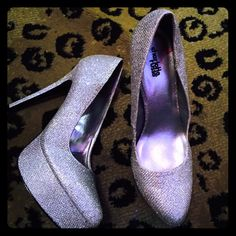 NWT SZ 10 silver sparkly heels Brand new silver sparkly heels never worn. There like perfect Cinderella shoes. I have way to many shoes and need to downsize Charlotte Russe Shoes Heels