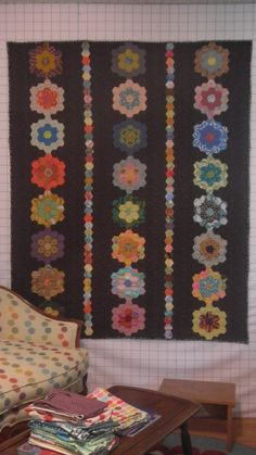 my friend Judy W's hexie quilt. Might steal this layout so I don't have to make so many flowers for mine