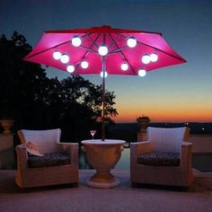 Exterior. Cozy outdoor living space decoration with pink umbrella table including natural wicker outdoor armchair and outdoor patio lighting design, Extraordinary Pictures Of Outdoor Patio Lighting Design Ideas
