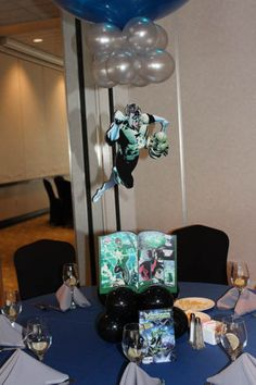 Comic Themed Balloon Centerpiece Comic Book Themed Balloon Centerpiece with Floating Superheroes and Custom Table Signs Balloon Inside Balloon, Balloons, Balloon Centerpieces, Balloon Decorations, Superhero Centerpiece, Table Signs, Balloon Bouquet, Book Themes, Bar Mitzvah