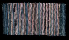 """Cowgirl 2, denim (recycled jeans) and pink stripes in a Fibonacci progression (1:2:3:5:8:13); twill weave.  64"""" x 34"""",  See this rug and more at www.rugsfromrags.com/rugs-woven."""