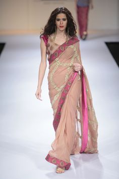 Beautiful saree colours. Don't like the golden criss cross in the middle that much, but loving the makeup with it as well