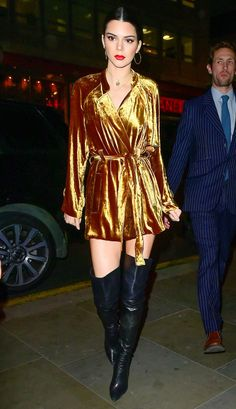 Fashion Week 2017: Stars in London, Paris and Milan - Kendall Jenner in a gold velvet romper and black over-the-knee boots