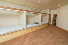 This house puts a new spin on bunk beds! Perfect for use as real family getaway, having beds set up like this allows for more open space in the downstairs and a true slumber party weekend environment. This custom house is located at Deep Creek Lake just steps from the slopes of Wisp Resort!