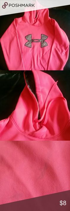 Hot pink Under Armor Sweatshirt Hot pink Under Armor Sweatshirt. Color is bright and gorgous. There are stains on the lower back. I could not get them out, but doesn't mean someone else can't!  This is pictured in pics 3 & 4. This is why I priced so low, so please note and ask any questions you need to before purchasing. It's still super comfy and such a beautiful color! Under Armour Tops