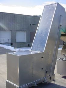"""1-USED O.Z.A.F. APPROX. 24"""" WIDE STAINLESS STEEL INCLINED CLEATED BELT ELEVATOR/FEEDER. PRESENTLY UNIT HAS DISCHARGE OF APPROX. 73"""" AND BOTTOM HOPPER MEASURING ABOUT 23"""" WIDE X 36"""" LONG X 32"""" DEEP. EQUIPPED WITH APPROX. 3"""" HIGH CLEATS WHICH ARE ON 11"""" CENTERS (CLEAT TO CLEAT). DRIVEN BY ELECTRIC MOTOR."""