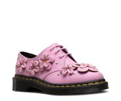 The 1461 is our original 3-eye shoe, and this is a fashion remix. Taking floral design to the next level, the sweet shoe brings together a bright shade of pink and 3-D hand-molded applique flowers — all toughened up by metal studding. Gloss metal eyelets Hand-molded applique flowers with metal studding Retains classic Doc's DNA, like grooved edges and yellow welt stitching Built on the iconic, durable Dr. Martens air-cushioned sole, with good slip-resistance and abrasion This is a Goodyea...