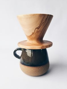 These personal coffee drippers are hand turned on the lathe then finished  with hand tools. Place on your favourite mug, drop in a size 2 filter and  some of your favourite roast, then slowly pour hot water to brew yourself a  single cup. The dripper are sealed with coconut oil & coffee oil.   This Item will dispatch within 1-2 weeks