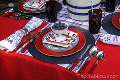 red table cloth, navy/white/red checkered runner, navy placemat, red/blue plates, patriotic