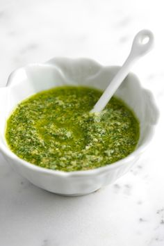 Greenest Basil Pesto Recipe from www.inspiredtaste.net - How to make the greenest, tastiest basil pesto recipe in a food processor with basil, nuts, garlic, olive oil and cheese.