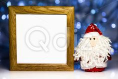 Qdiz Stock Photos | Santa Claus and blank wooden frame,  #backdrop #background #beard #blank #celebration #Christmas #Claus #Clause #closeup #decoration #doll #empty #eve #Father #figure #frame #frost #fun #funny #greeting #holiday #light #little #Merry #new #red #Santa #small #toy #traditional #white #wood #wooden #x-mas #xmas #year