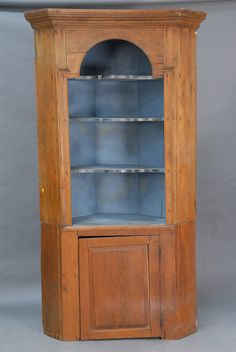 """Primitive corner cupboard in two parts, open top and one door in base.    Dimensions: ht. 7'3"""", wd. 46"""""""