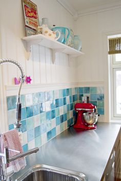 Love the bright aqua, red, yellow scheme for the kitchen.