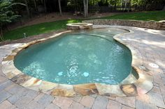 Small natural pool with spa - by Sunbelt Pools of Georgia