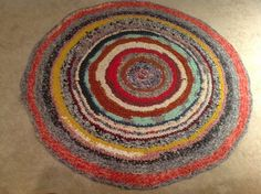 Love the colors and primitive nature of this braided rug