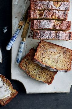 This banana bread recipe incorporates pecans, mashed bananas, sour cream, vanilla and dark rum to create the ultimate boozy brunch recipe. Whether you're eating this smashed banana bread recipe as a snack, an appetizer, a side dish, or as a brunch favorite alongside a mimosa, it's a great choice for a banana bread with a twist.#bananabread #bananabreadrecipes #brunchrecipes #breakfastrecipes #boozyrecipes #rumrecipes Best Brunch Recipes, Rum Recipes, Banana Bread Recipes, Breakfast Recipes, Pecans, Bananas, Sour Cream, Side Dishes, French Toast