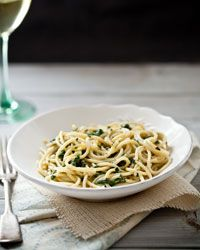 Spaghetti with Creamy Spinach and Tarragon  Cream cheese melts in the heat of the pasta to form a luscious sauce. The fresh spinach called for here provides a delicate flavor that frozen spinach just doesn't duplicate.