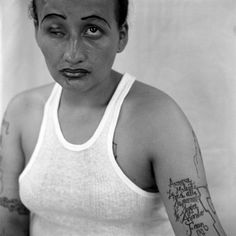 """Gang Mara18 by Christian Poveda   """"La Wizard"""", after the Marvel comics. 27 years old, a young mother of four who had lost her eye in a fight and is interviewed undergoing a series of treatments to be fitted with a glass eye. She is later shot and killed during the filming of La Vida Loca."""