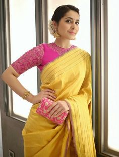 Looking for best contrast blouse ideas to try with yellow saree? Here are 13 pretty colors that can add whole lot of charm to your vibrant yellow sarees! Pink Saree Blouse, Pattu Saree Blouse Designs, Blouse Designs Silk, Saree Blouse Patterns, Latest Saree Blouse Designs, Designer Saree Blouses, Wedding Saree Blouse Designs, Grey Blouse, Linen Blouse