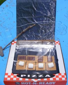 Making s'mores in a pizza box solar oven shows kids that they can do awesome things using the sun's energy!