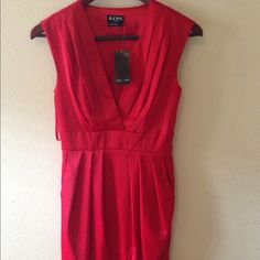 BCBG red dress Red sexy dress! Tags removed and worn once. No flaws. Has pockets. Makes your waist look tiny 25% off bundles!!! BCBGMaxAzria Dresses Mini