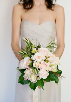 Light light gray bridesmaids + pale pink + ivory #bouquet  || See the wedding on Style Me Pretty-- http://www.StyleMePretty.com/2014/02/12/california-family-style-ranch-wedding/Photography: Adriana Klas