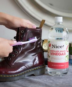 Scrub off water stains on leather boots with a soft toothbrush and vinegar If your boots are ruined from water, snow, salt, or all of the above, dip a soft-bristled toothbrush in white vinegar and gently rub to remove the stain.
