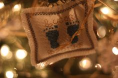 a little cross-stitched ornament for our 1st grandson's first Christmas...