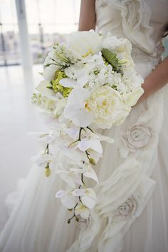 White Cascading Orchid Bridal Bouquet | Good Earth Floral Design | Weddings By Hannah | epagaFOTO https://www.theknot.com/marketplace/epagafoto-kansas-city-ks-233646