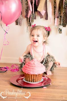first birthday cake smash cute girl pink and cheeta sweet laugh
