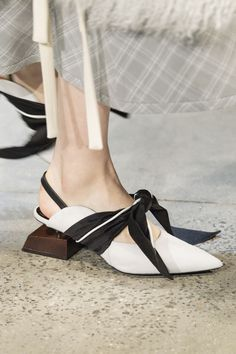These white slingbacks at Prabal Gurung had a black bow loosely tied around the front, and they also featured an asymmetrical wooden heel. Big Bows - Cosmopolitan.com