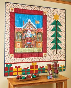 SANTA'S ELF: Start with a large panel showing Santa and an elf at the North Pole, add a tall pine tree and some presents, and you have a wall quilt pattern that everyone will love. This holiday quilt pattern is the perfect way to welcome guests into your home for the holiday season!