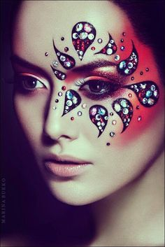 Artistic rhinestone accented black tear drop and red shimmer fantasy makeup by Marina Bukko Photography.
