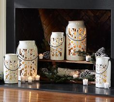 Snowflake Punched Ceramic Lanterns white is also a part of my woodland wonderland decor! these are perfect to hang from the ceiling over the mantle in 3's and in varying sizes!
