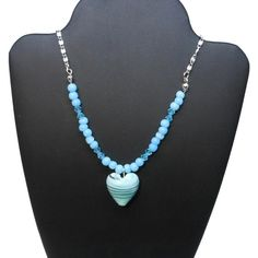 """Use code SOCIAL15 for 15% off all purchases over $15, plus FREE shipping on most jewelry! Lampwork heart necklace, blue heart with striped swirls of black & white, blue Swarovski crystals, cats eye glass, silver plated chain  The necklace measures 18"""" (45.7 cm) ... #etsygifts #vintage #vjse2 #jewelry #gift"""